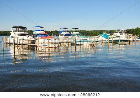 boats at docks on a lake