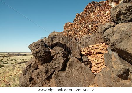 Citadel Pueblo, red and black volcanic stone ruins
