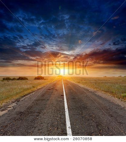 countryside road on sunset sky background