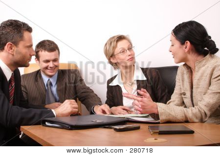 Group Of People Negotiate At The Desk
