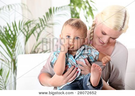 Mother and baby  sitting on a sofa