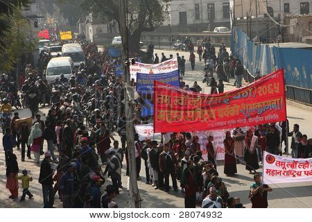 KATHMANDU, NEPAL - DECEMBER 30: Nepalese caste Gurung celebrate their traditional New Year. A procession in traditional costumes goes around the city, men beat the drums, and women dance, December 30, 2008.