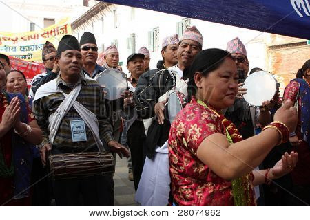 KATHMANDU, NEPAL - DECEMBER 30: Nepalese caste Gurung celebrate their traditional New Year. A procession in traditional costumes goes around the city, December 30, 2008.