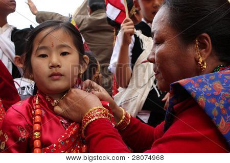 KATHMANDU, NEPAL - DECEMBER 30: Nepalese caste Gurung celebrate their traditional New Year on December 30, 2008 in Kathmandu, Nepal. A procession in traditional costumes goes around the city.