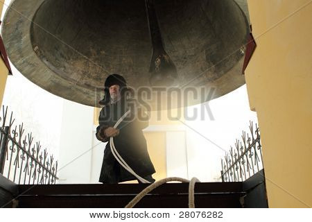 TOMSK, RUSSIA - JANUARY 19: Bell-ringer in the belfry, celebration of Epiphany (Holy Baptism) in the Orthodox tradition, January 19, 2010 in Tomsk, Russia.
