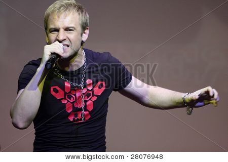 "TOMSK, RUSSIA - JUNE 6: Roman Chernitsyn - frontman of disco group ""Plazma"" performing in a night club ""Teatro"", June 6, 2009 in Tomsk, Russia."