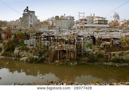 KATHMANDU, NEPAL - JANUARY 2: Not-tourist side of Kathmandu, houses of poor people in Old Baneshwor, banks of Bagmati river, January 2, 2009 in Kathmandu, Nepal.