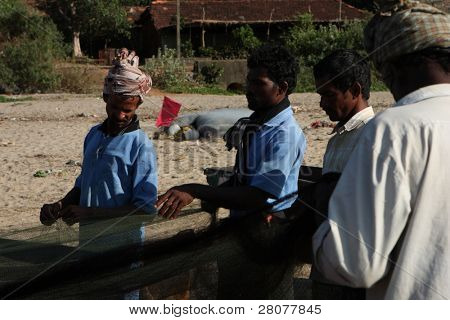 GOKARNA, INDIA - DECEMBER 14: Fishermen from Indian state Karnataka, prepare gear for fishing in the Indian ocean, December 14, 2008 in Gokarna, India.