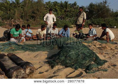 GOKARNA, INDIA - DECEMBER 16: Fishermen from Indian state Karnataka, prepare gear for fishing in the Indian ocean, December 16, 2008 in Gokarna, India.