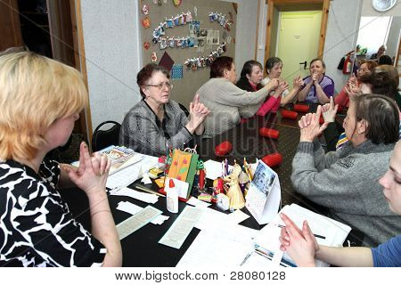 PODPOROZHYE, RUSSIA - MARCH 11: Day of Health in Center of social services for pensioners and the disabled Otrada (occupational therapy for eldery), March 11, 2010 in Podporozhye, Russia.