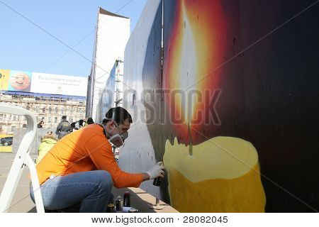 MOSCOW - MARCH 31: An unidentified man sprays paints during â??Generation Against Terrorâ? anti-terror demonstration at Triumphal Square on March 31, 2010 in Moscow.