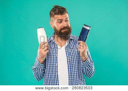 Man Bearded Hipster Choose Shampoo