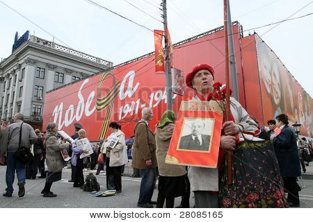 MOSCOW - MAY 1: Communist party supporters take part in a rally marking the May Day, a portrait of the Soviet founder Vladimir Lenin, May 1, 2010 in Moscow, Russia.