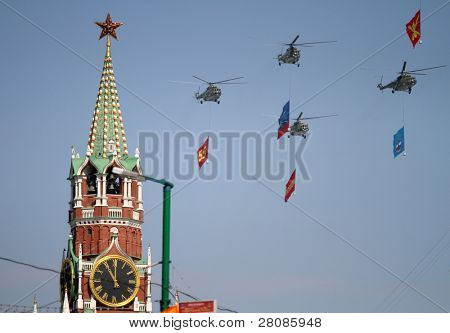 MOSCOW - MAY 9: MI-8 multipurpose helicopters fly over Red Square during the Military Parade dedicated to the 65th anniversary of the Victory in the Great Patriotic War, May 9, 2010 in Moscow, Russia.