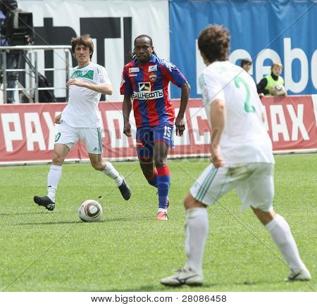 MOSCOW - MAY 10: CSKA's Chidi Odiah (C) in action during their team's Russian football championship game CSKA (Moscow) vs. Terek (Grozny) - (4:1), May 10, 2010 in Moscow, Russia.