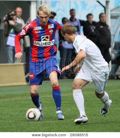 MOSCOW - MAY 10: CSKA's Milos Krasic (L) in action during their team's Russian football championship game CSKA (Moscow) vs. Terek (Grozny) - (4:1), May 10, 2010 in Moscow, Russia.