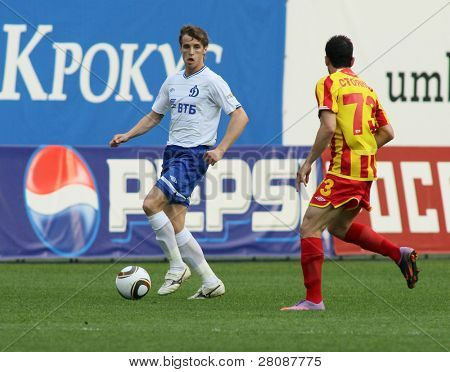 MOSCOW - MAY 15: Dinamo's midfielder Kirill Kombarov (L) in a game of the 11th round of Russian Football Premier League - Dinamo Moscow vs. Alania Vladikavkaz - 2:0, May 15, 2010 in Moscow, Russia.