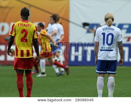 MOSCOW - MAY 15:  Alania's defender Ibrahim Gnanou (L) and Dinamo's forward Andrei Voronin (R) in a game Dinamo Moscow vs. Alania Vladikavkaz - 2:0, May 15, 2010 in Moscow, Russia.