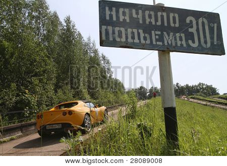 DMITROV, RUSSIA - JUNE 13: A unidentified participant reaches the top in Lotus Exige  in the first Championship 'Rus Hill climb Open' at avtopoligone NIITSAMT, June 13, 2010 in Dmitrov, Russia.