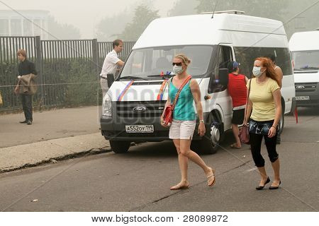 MOSCOW - AUGUST 7: Masked residents seeking to protect their respiratory channels as the carbon monoxide content in the air is increasing due to raging forest fires, August 7, 2010 in Moscow, Russia.