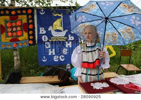 VINNICI, LENINGRAD REGION, RUSSIA - JUNE 12: An unidentified child celebrates of the annual holiday Vepsian national culture