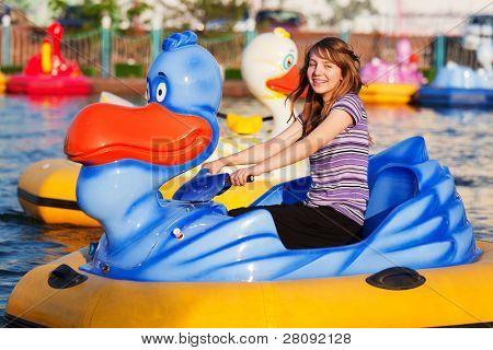 Teenage girl having a fun in water park