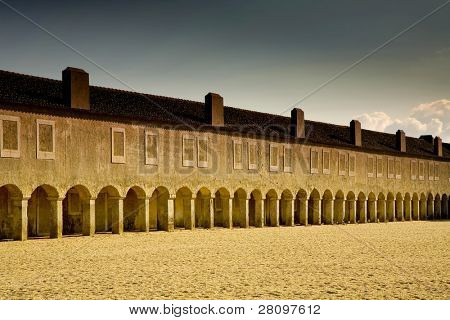 monastery in cape Espichel, in portugal, at sunset light, view of the peligrims rooms