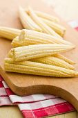 Baby corn cobs on kitchen table