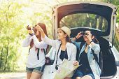 Travel Group Asian Woman Traveler Sitting On Hatchback Car For Trip Road With Outdoors Forest In Vac poster