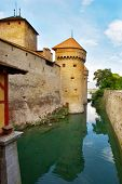 Medieval well-known fortress Shillon on lake Leman poster