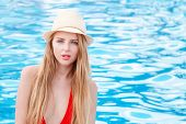 Beautiful Sexy Woman Relaxing In Swimming Pool. Blonde Girl With Gorgeous Face, Fashion Makeup And W poster