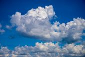 White Cloud On Blue Sky. Sunny Cloudscape Photo Background. Optimistic Skyscape With Fluffy Cloud. F poster