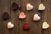 Heart-shaped Confection For Valentines Day On Dark Wooden Background Top View poster