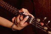 Instrumental Music Live. Couple In Love Play Duets. Male And Female Hands Play The Electric Guitar.  poster