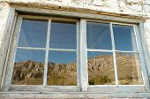 picture of stagecoach  - Guadalupe Ranch House window reflection of mountains - JPG