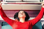 Athletic Girl Raises Barbell Lying On The Bench On The Simulator In The Gym. Sport Weightlifting Bod poster