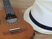 A Samba Player (sambista) Hat And A Cavaquinho (a Small Brazilian String Musical Instrument) On A Wo poster