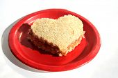 Peanut Butter and Jelly Sandwich. Heart Shaped Peanut Butter and Jelly Sandwich on a Red Paper Plate poster