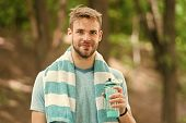 Drink Some Water. Man Jogger With Towel On Shoulders Holds Water Bottle. Man Athlete Sport Clothes R poster