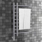 Bathroom Towel Heater Warmer Rail With Towel In Front Of Gray Tiles Wall. 3d Rendering poster