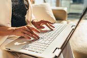 Closeup Of Woman Hands Typing On Laptop Keyboard poster