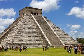 CHICHEN ITZA, MEXICO - AUGUST 11: crowded main pyramid on August 11, 2010 in Chichen Itza, Yucatan,