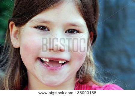 happy smiling toothless little girl