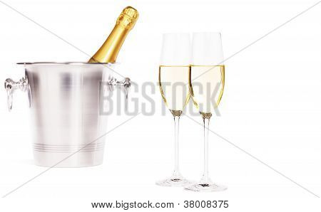 two glasses of champagne with a champagne bottle in a bucket