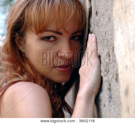 Girl Near Stones Wall