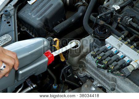 .handsome Mechanic Working In Auto Repair Shop