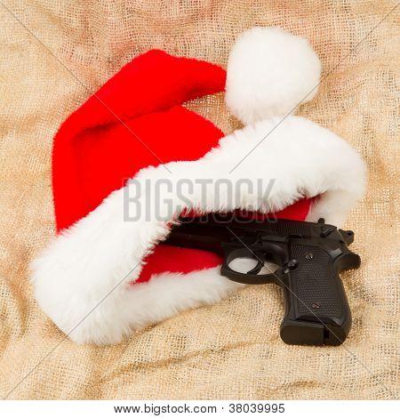 Weapon (firearm) Concealed In Santas Hat