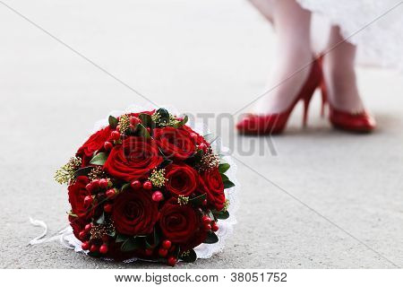 Wedding bouquet and bride's feet