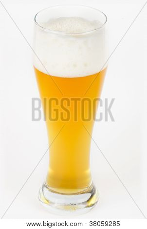 A glass of unfiltered beer on white