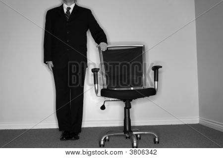 Businessman And Empty Chair